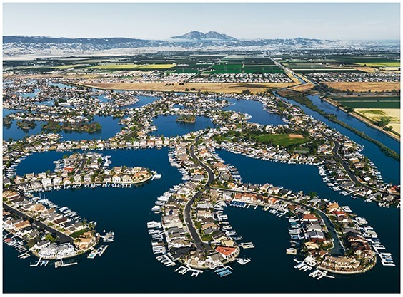 California, USA, 2009  As developments such as Discovery Bay increase in the Sacramento-San Joaquin Delta, so does the flood hazard. More than a million people now live behind delta levees, which are susceptible to increasingly severe coastal storms.