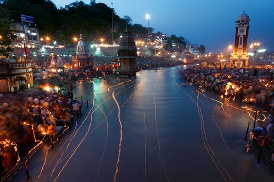 India, 2009  India's holiest river, the Ganges, is scribbled with light from floating oil lamps during the Ganga Dussehra festival in Haridwar. Hindus near death often bathe in the river; some are later cremated beside it and have their ashes scattered in its depths.