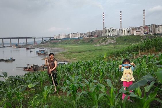 China, 2009  In Chongqing—a burgeoning Chinese municipality whose 31 million people tap the Yangtze River for their needs—coal-fired, carbon-dioxide-spewing power plants compete with family farms for water.