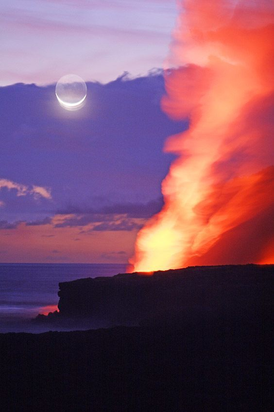 Lava flows into the sea as a crescent moon rises in this double exposure taken at dusk.