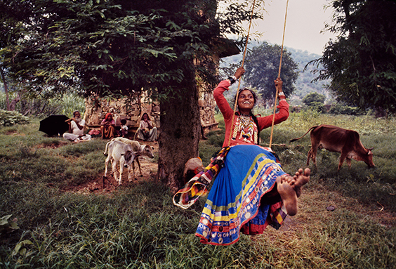 Rajasthan, India A young woman enjoys time with her family after the monsoons.