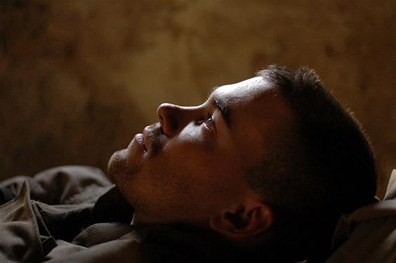 Cpl. Joel Chaverri, a USMC combat cameraman attached to Bravo Company, 1st Battalion, 8th Marine Regiment, takes a break during the battle of Falluja, Iraq on November 13, 2004. (Photo by Ashley Gilbertson / VII Network)