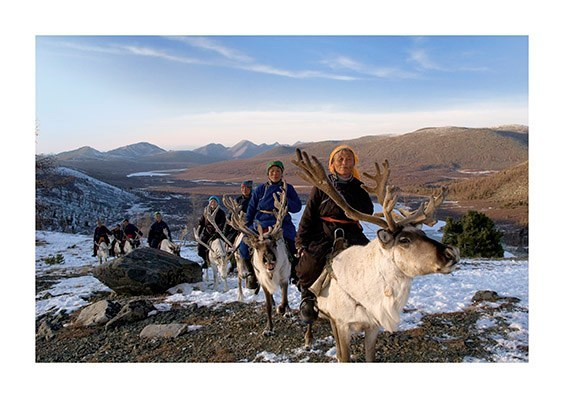 Hovsgol Taiga, Mongolia  Women heading into a valley to round up the reindeer herds for the evening.