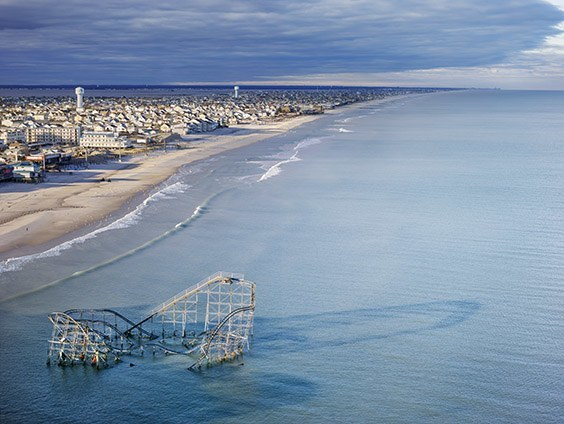 The roller coaster from the boardwalk in Seaside Heights, New Jersey partially submerged in the ocean after Hurricane Sandy.