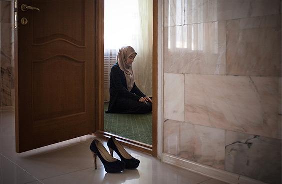 Amina Mutieva , 21, a student at the Islamic University in Grozny prays in a prayer room for women.
