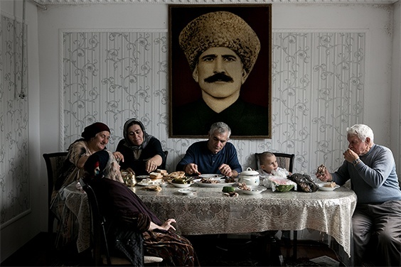 For the project 'Hidden War' , North Caucasus, Russia: Family members have dinner with the sacrificed sheep as a part of the celebration of Eid al-Adha, a feast celebrated by Muslims worldwide. In Russia it is called Kurban-Bairam and is widely celebrated in the North Caucasus republics. 16.10.2013. Village of Tarumovka, Dagestan, North Caucasus, Russia.
