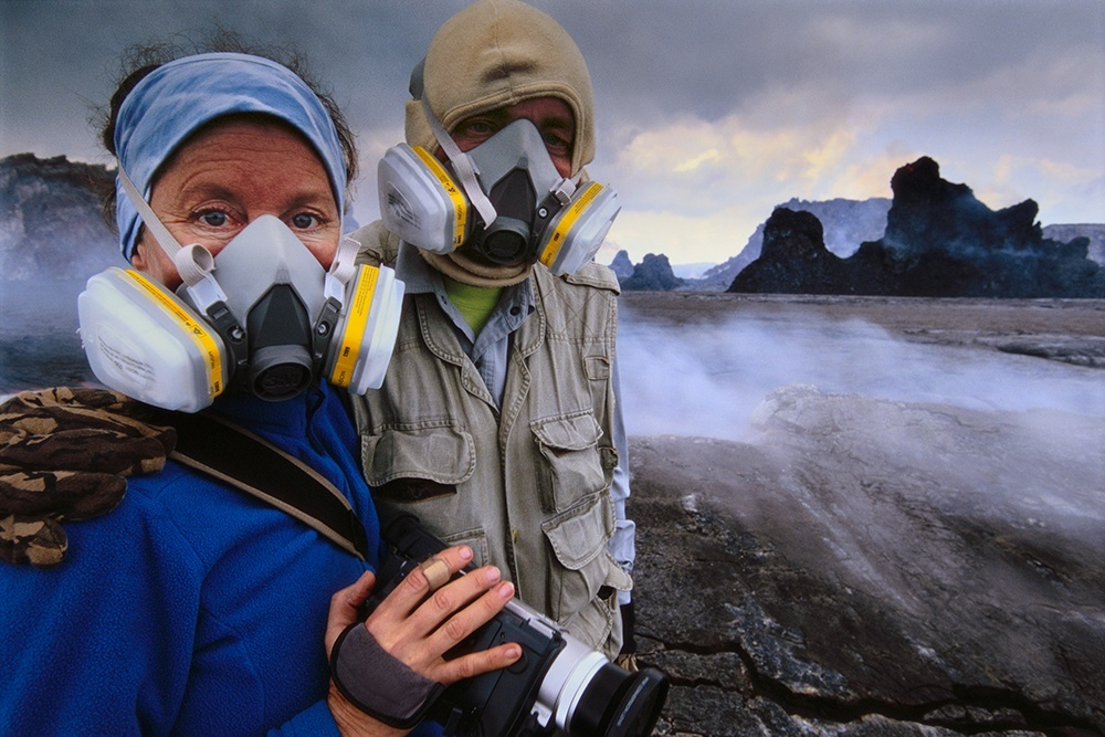 Frans Lanting and Christine Eckstrom at edge of volcano, Hawaii