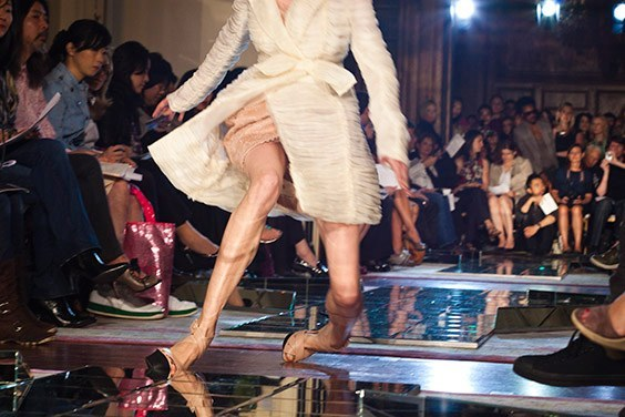 A model falls at Jason Wu's Spring 2010 show at the St. Regis Hotel, New York, New York.