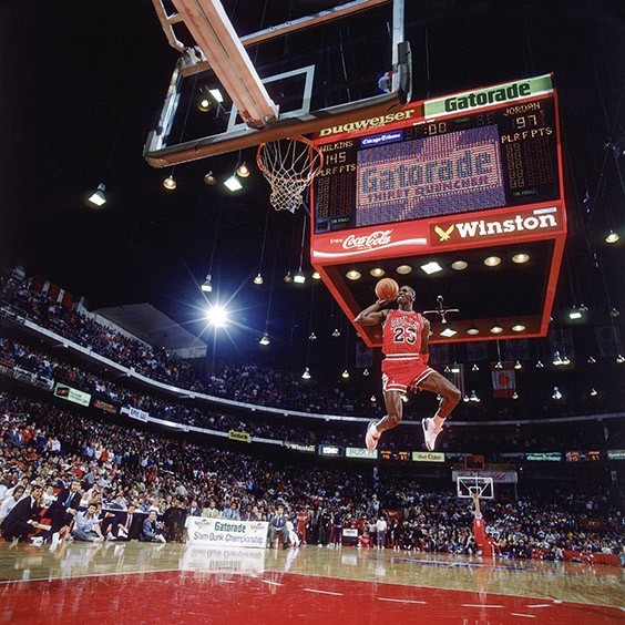 """Chicago, IL, 1998  The problem with shooting the NBA slam-dunk contest was that you never knew how the players were going to dunk, especially Jordan. As he sat in the stands three hours before the contest, I said, """"Michael, can you tell me which way you're going to go, so I can move and get your face in the picture?"""" He looked at me as if I were crazy but then said, """"Sure. Before I go out to dunk I'll put my index finger on my knee and point which way I'm going."""" So later, when they announced his name, I looked over to him on the bench and there was his finger pointing left."""