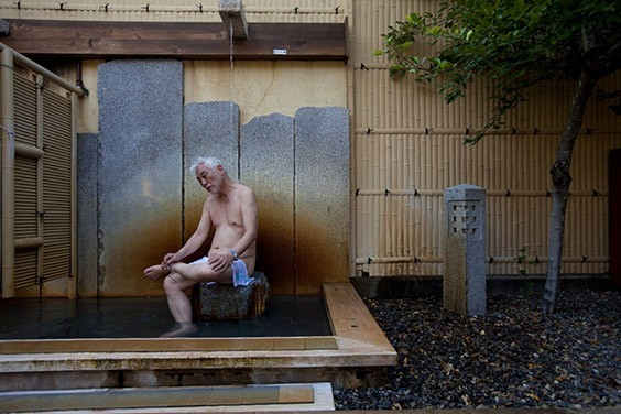 """Japan, 2009  Tending body and soul, Taizo Noda bathes in the mineral-rich waters of an onsen, or hot spring, near Osaka, Japan. Hours spent soaking, says the 72-year-old, are """"the secret of long life."""""""