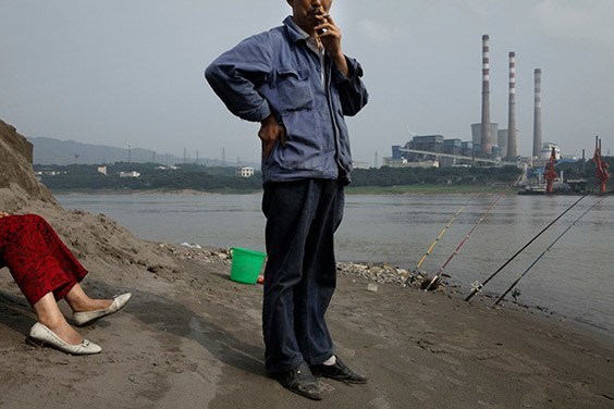 China, 2009  Near Chongqing, China, in the industrial town of Luohuangshi, a husband and wife fish in the Yangtze River. Waterways like this one are lifelines for some of Asia's most densely settled areas, including China's thirsty metropolises.