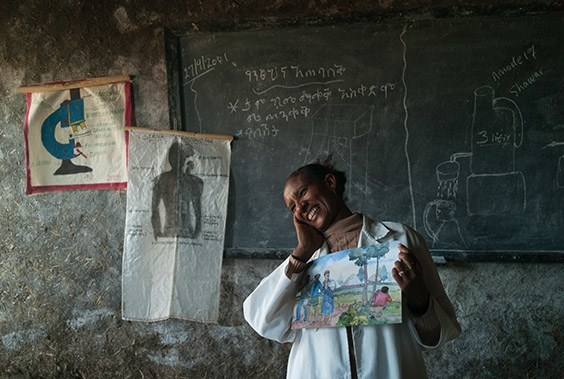 Ethiopia, 2009  In Ticho, Ethiopia, a drawing of a man defecating elicits laughter from Hiruut Nigusee, who uses the picture in her hygiene classes. At first students were embarrassed, but now they use the latrine, wash their hands and suffer fewer bouts of diarrhea.
