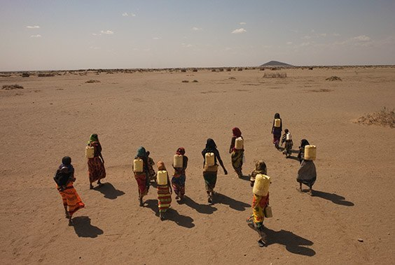 Kenya, 2009  Tribal Gabra women in northern Kenya (right) may need five hours a day to lug jerry cans laden with murky water across the desert. A lingering drought has pushed this already arid region into a full-blown water crisis.
