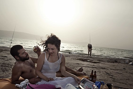 Israel, 2009  Israelis relax by the Sea of Galilee, a lake near the Golan Heights that is fed by the Jordan River and that supplies a third of Israel's fresh water.