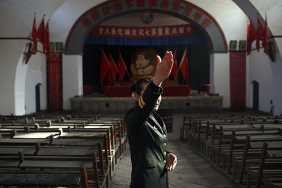 A candidate takes the oral test to become a tour leader at the Yangjialing Assembly Hall in Yan'an, China, on November 8, 2009. In 1945, the Seventh National Congress of the Communist Party of China was held here, naming Mao Zedong the undisputed leader and enshrining Mao Zedong Thought into the Party Constitution.