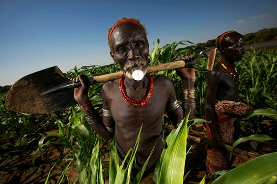 Loryra, South Omo, Ethopia A Dassanech man tending to his fields along the Omo River. A hydroelectric company has plans to construct a massive dam that will inundate much of the Omo Valley, forcibly displacing tribal societies that have lived there for generations.