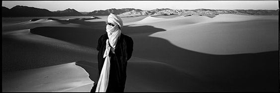Sahara desert, Niger A guide plots his route through the weave of sand dunes that reach across the Sahara Desert, where the harsh environment has shaped the beliefs of those whose lives it affects.