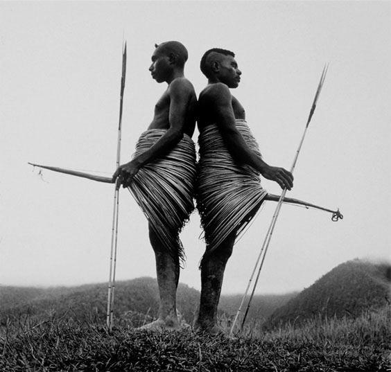 Anguruk area, Highlands, Irian Jaya, New Guinea Two Yali warriors with traditional battle penis sheaths and rattan skirts.