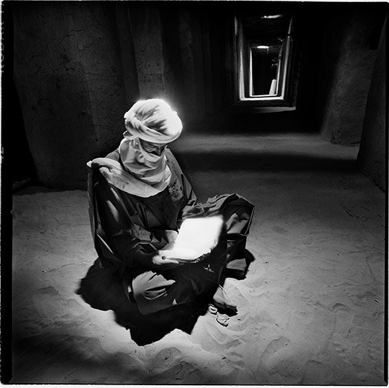 Timbuktu, Mali A Tuareg man reads the Koran in a mosque. In Timbuktu there remains a repository of thousands of ancient manuscripts, dating to a time when the city rivaled Damascus, Baghdad and Cairo as one of the great centers of Islamic culture and learning.