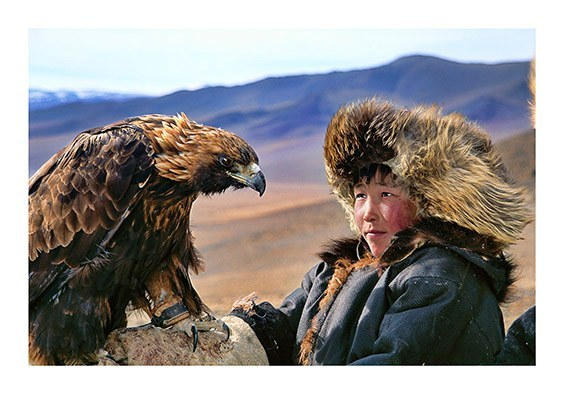 Deloun Highlands, Olgii Province, Outer Mongolia Khoda Bergen, a young Kazakh shepherd, is being trained to hunt with his uncle's hunting eagle.