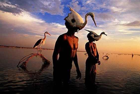 Indus River, Mohenjo Daro, Pakistan On the Indus river, bird hunters employ a technique that has been practiced for 5,000 years, according to archaeological records. They tie a living heron to a hoop, and then, wearing masks made from bird skins, submerge themselves to their necks in the water. Wiggling their heads to mimic swimming birds, they attract their prey and grab the wild birds as they land on the water.