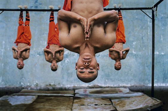 Henan Province, China Young monks train at the Shaolin Monastery in Henan Province, China. The physical strength and dexterity displayed by the monks is remarkable, as is their serenity.