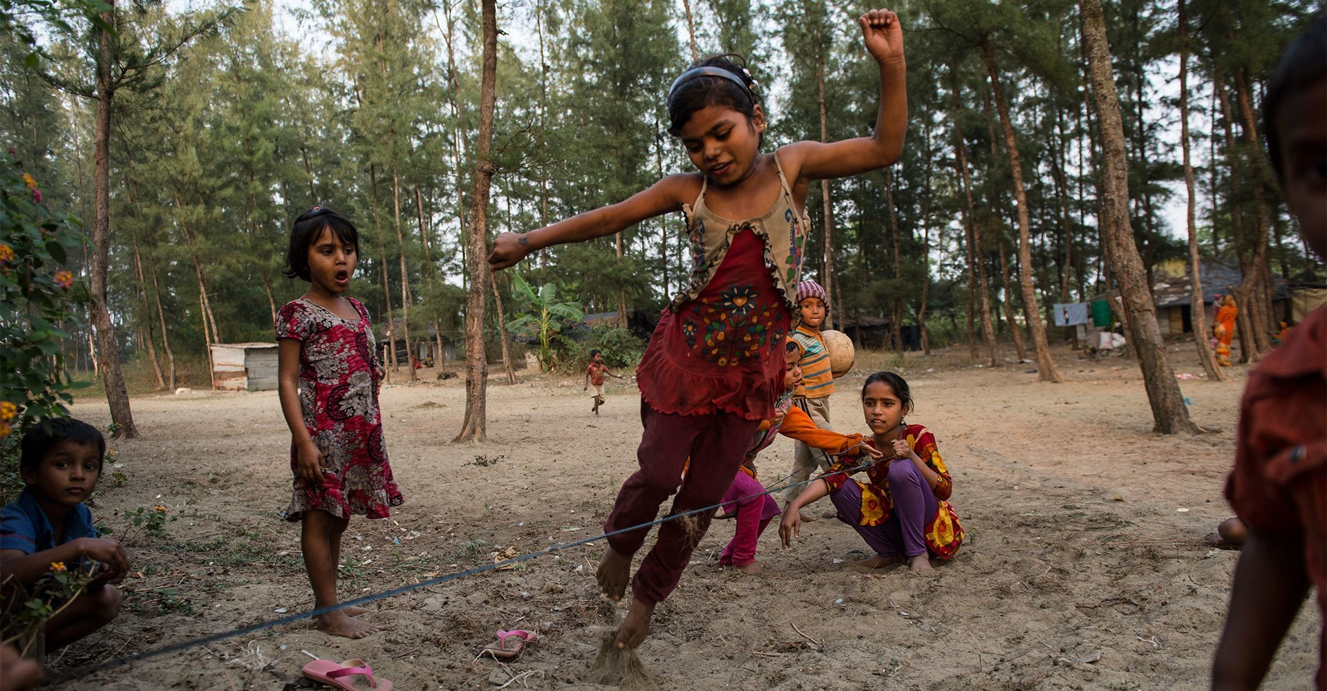 Ukhia settlement, Bangladesh, 2016: Munni, 8, jumps rope with her friends.  They all attend a nearby community school.